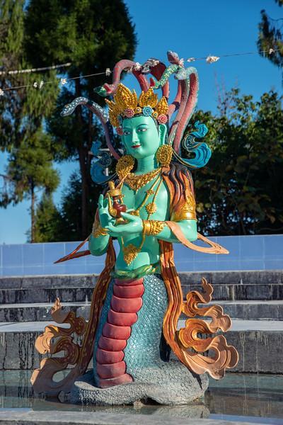 Statues at Sangachuling Monasetery / Chenrezing (गैंट स्टैचू संगचुलिंग मोनासेतेरी / चेंरेजिंग). Sanghak Choeling Monastery (संघक चोएलिंग मोनास्ट्री), Pelling City, Sikkim is a 17th-century Buddhist monastery near Kanchandzanga. North East India.