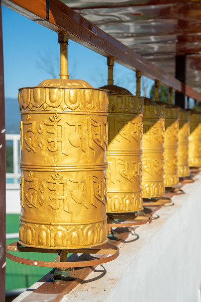 Buddhist golden prayer wheels at Sanghak Choeling Monastery (संघक चोएलिंग मोनास्ट्री), Pelling City, East Sikkim, North East India. This 17th-century Buddhist monastery is located on a hill near Kanchandzanga mountain.