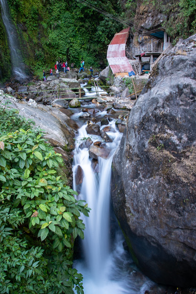 Tourists visiting the Kanchandzanga Falls (कन्चंद्ज़ंगा फॉल्स), Pelling-Yaksam Road, Sikkim, North East India.