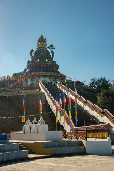 Gaint Statue Sangachuling Monasetery / Chenrezing (गैंट स्टैचू संगचुलिंग मोनासेतेरी / चेंरेजिंग) is located at Sanghak Choeling Monastery (संघक चोएलिंग मोनास्ट्री), Pelling City, Sikkim which is a 17th-century Buddhist monastery near Kanchandzanga, North East India.