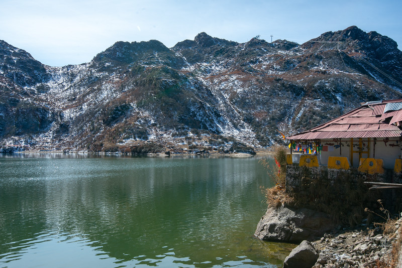 Tsomgo Lake (त्सोम्गो लेक) shore offering yak rides during season. The Tsomgo lake at an altitude of over 10,000 ft is surrounded by mountains.