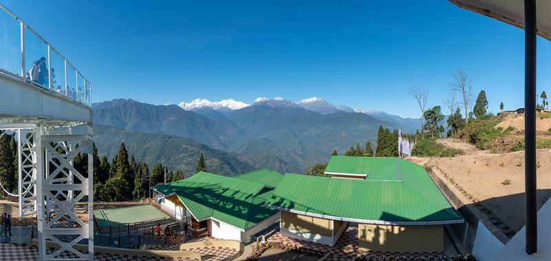 Panoramic view. Sky Walk Pelling Sikkim (स्काई वॉक पेल्लिंग सिक्किम) at the Sanghak Choeling Monastery (संघक चोएलिंग मोनास्ट्री), Pelling City, Sikkim. This 17th-century Buddhist monastery on a hill has a great view of Kanchandzanga mountain. North East India.