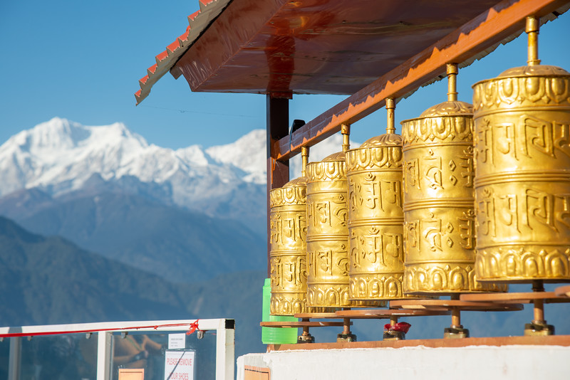 Buddhist golden prayer wheels with a great view of Kanchandzanga mountain from Sanghak Choeling Monastery (संघक चोएलिंग मोनास्ट्री), Pelling City, Sikkim. North East India.