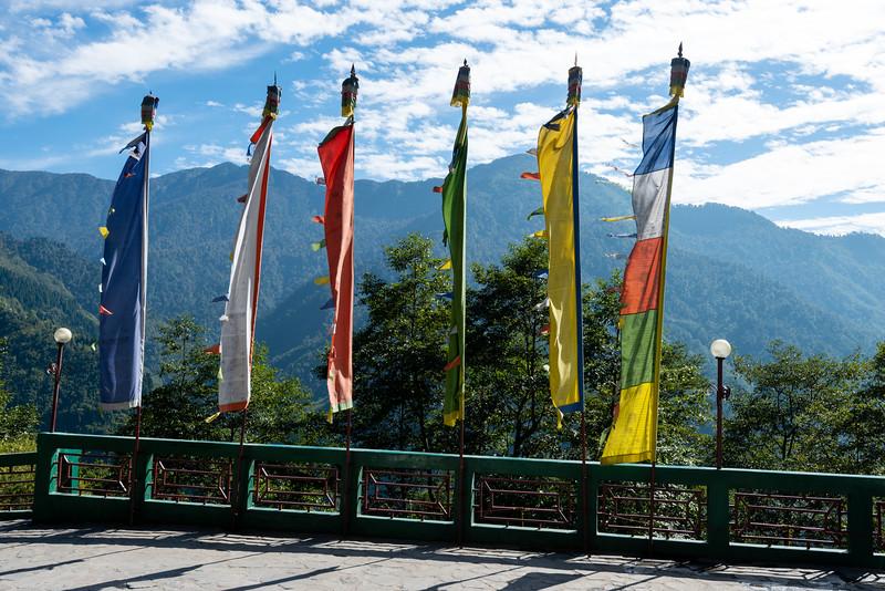 Flags flutter in the winds at Club Mahindra Gangtok, Gangtok, East Sikkim, India.