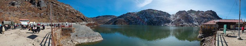 panoramic view of Tsomgo Lake (त्सोम्गो लेक). The Tsomgo lake is located at an altitude of over 10,000 ft and surrounded by mountains.