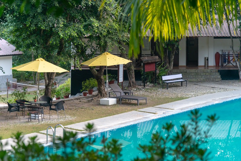 Swimming pool area at Club Mahindra Baiguney, क्लब महिंद्रा बैगुनी, Jorethang, Sisney, Pipaley, Sikkim. North East India.<br /> <br /> Set on 12 acres overlooking the Rangeet River, this cozy mountainside resort is 23 km from Tenzing Rock and 29 km from the Padmaja Naidu Himalayan Zoological Park.