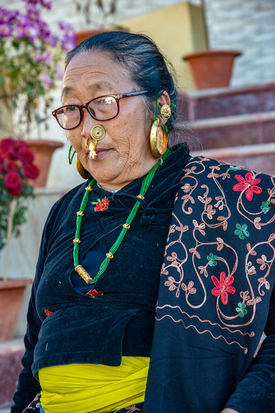 Street portrait of Sikkim lady in traditional attire at monastery. <br /> <br /> Sanghak Choeling Monastery (संघक चोएलिंग मोनास्ट्री), Pelling City, Sikkim is a 17th-century Buddhist monastery in a remote area on a hill. North East India.
