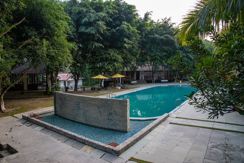 Swimming pool area at Club Mahindra Baiguney, क्लब महिंद्रा बैगुनी, Jorethang, Sisney, Pipaley, Sikkim 737121. North East India.<br /> <br /> Set on 12 acres overlooking the Rangeet River, this cozy mountainside resort is 23 km from Tenzing Rock and 29 km from the Padmaja Naidu Himalayan Zoological Park.