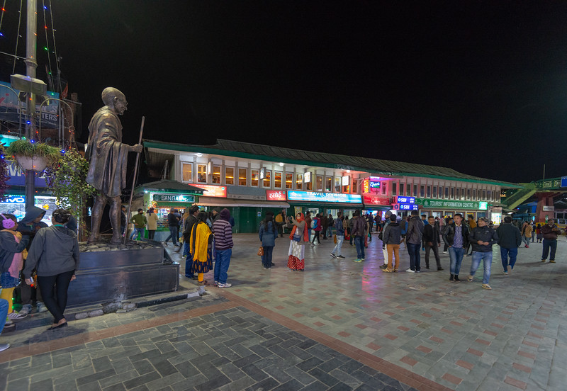 Mahatma Gandhi statue at the start of M.G. Mall Road, Arithang, Gangtok, Sikkim, North East India. <br /> <br /> Mahatma Gandhi Road or MG Road, is a street which is one of the focal point for tourists in Gangtok. Lined with shops both with branded items and with street-bargaining style shops.