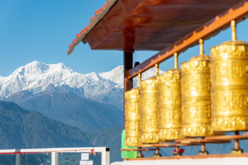Buddhist golden prayer wheels with a great view of Kanchandzanga mountain from Sanghak Choeling Monastery (संघक चोएलिंग मोनास्ट्री), Pelling City, Sikkim. North East India.