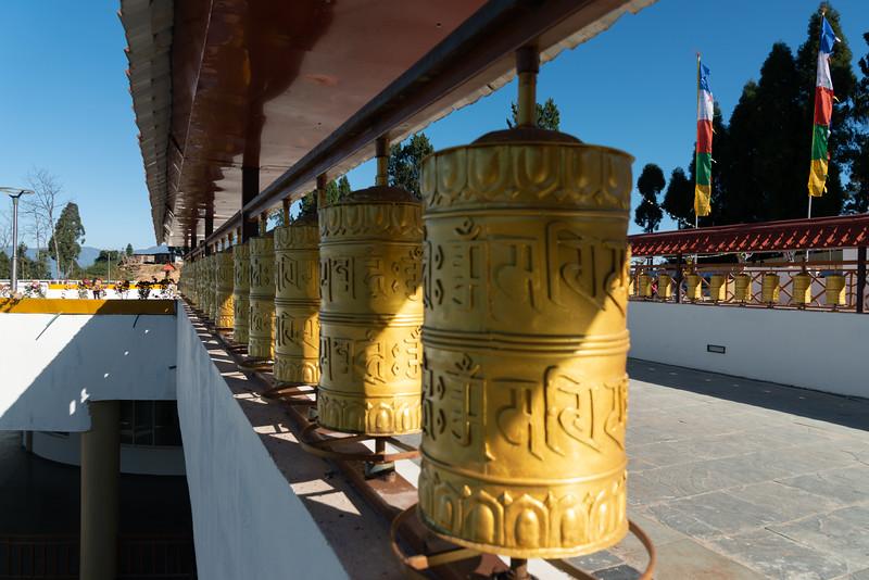 Buddhist golden prayer wheels at Sanghak Choeling Monastery (संघक चोएलिंग मोनास्ट्री), Pelling City, Sikkim, North East India. This 17th-century Buddhist monastery is located on a hill near Kanchandzanga mountain.
