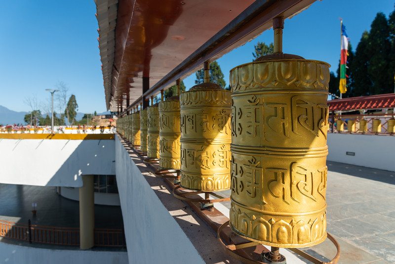 Buddhist golden prayer wheels at Sanghak Choeling Monastery (संघक चोएलिंग मोनास्ट्री), Pelling City, Sikkim, North East India. This 17th-century Buddhist monastery is located on a hill near Kanchandzanga mountain.