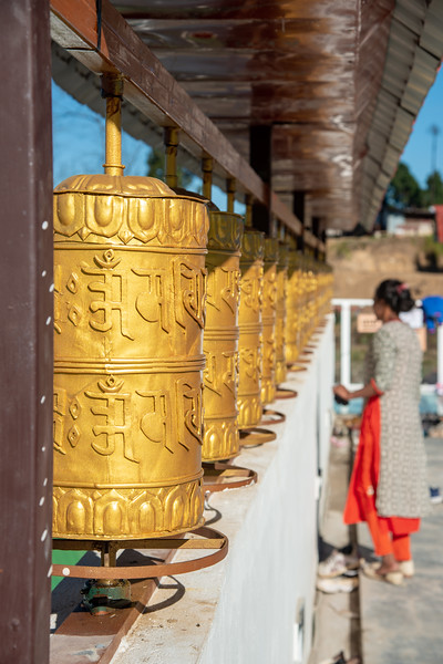 Buddhist golden prayer wheels at Sanghak Choeling Monastery (संघक चोएलिंग मोनास्ट्री), Pelling City, Sikkim. This 17th-century Buddhist monastery is located on a hill near Kanchandzanga mountain.