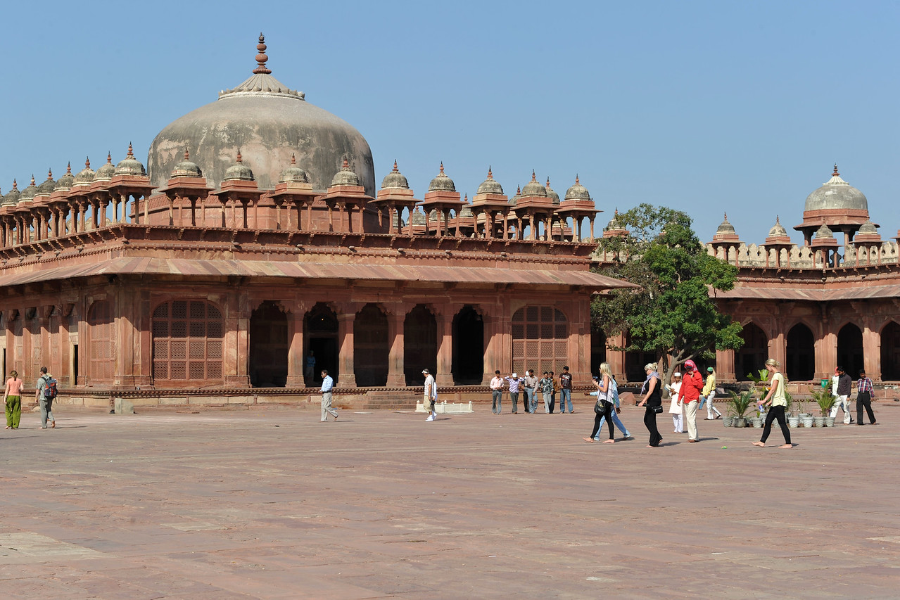 Jama Masjid: The mosque, built in the manner of Indian mosques, with liwans around a central courtyard. A distinguishing feature is the row of chhatri over the sanctuary. <br /> <br /> Fatehpur Sikri (Hindi: फतेहपुर सीकरी, Urdu: فتحپور سیکری) is a city and a municipal board in Agra district in the state of Uttar Pradesh, in North India. The historical city was constructed by Mughal Emperor Akbar beginning in 1570 and served as the empire's capital from 1571 until 1585. Though it took 15 years to build, it was abandoned after only 14 years of use because of shortage of water supply which was unable to sustain the growing population. The palace and mosque in Fatehpur Sikri are a tourist attraction and it is an UNESCO World Heritage Site which is about 40 km from the Taj Mahal, Agra. Uttar Pradesh state (UP), North India.