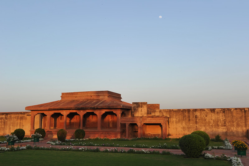 Lovely evening light casting a nice tone at Fatehpur Sikri.<br /> <br /> Fatehpur Sikri (Hindi: फतेहपुर सीकरी, Urdu: فتحپور سیکری) is a city and a municipal board in Agra district in the state of Uttar Pradesh, in North India. The historical city was constructed by Mughal Emperor Akbar beginning in 1570 and served as the empire's capital from 1571 until 1585. Though it took 15 years to build, it was abandoned after only 14 years of use because of shortage of water supply which was unable to sustain the growing population. The palace and mosque in Fatehpur Sikri are a tourist attraction and it is an UNESCO World Heritage Site which is about 40 km from the Taj Mahal, Agra. Uttar Pradesh state (UP), North India.