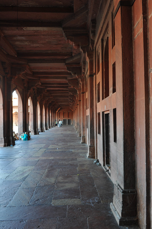 Fatehpur Sikri (Hindi: फतेहपुर सीकरी, Urdu: فتحپور سیکری) is a city and a municipal board in Agra district in the state of Uttar Pradesh, in North India. The historical city was constructed by Mughal Emperor Akbar beginning in 1570 and served as the empire's capital from 1571 until 1585. Though it took 15 years to build, it was abandoned after only 14 years of use because of shortage of water supply which was unable to sustain the growing population. The palace and mosque in Fatehpur Sikri are a tourist attraction and it is an UNESCO World Heritage Site which is about 40 km from the Taj Mahal, Agra. Uttar Pradesh state (UP), North India.