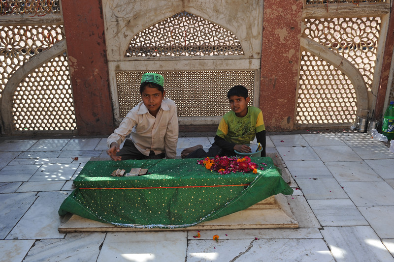 Families particularly women wanting children or those who got children perform prayers sufi saint Salim Chis's tomb at Fatehpur Sikri (Hindi: फतेहपुर सीकरी, Urdu: فتحپور سیکری) is a city and a municipal board in Agra district in the state of Uttar Pradesh, in North India. The historical city was constructed by Mughal Emperor Akbar beginning in 1570 and served as the empire's capital from 1571 until 1585. Though it took 15 years to build, it was abandoned after only 14 years of use because of shortage of water supply which was unable to sustain the growing population. The palace and mosque in Fatehpur Sikri are a tourist attraction and it is an UNESCO World Heritage Site which is about 40 km from the Taj Mahal, Agra. Uttar Pradesh state (UP), North India.