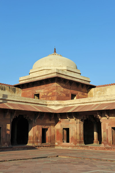 The Fatehpur Sikri site's prominent civic buildings include public and private audience halls where state business was conducted and where Akbar held religious councils that led to the creation of his new faith, the Din-i-Ilahi. The harem, imperial palaces, and the houses of Akbar's wives are among the key structures of the complex's residential area.<br /> Fatehpur Sikri (Hindi: फतेहपुर सीकरी, Urdu: فتحپور سیکری) is a city and a municipal board in Agra district in the state of Uttar Pradesh, in North India. The historical city was constructed by Mughal Emperor Akbar beginning in 1570 and served as the empire's capital from 1571 until 1585. Though it took 15 years to build, it was abandoned after only 14 years of use because of shortage of water supply which was unable to sustain the growing population. The palace and mosque in Fatehpur Sikri are a tourist attraction and it is an UNESCO World Heritage Site which is about 40 km from the Taj Mahal, Agra. Uttar Pradesh state (UP), North India.