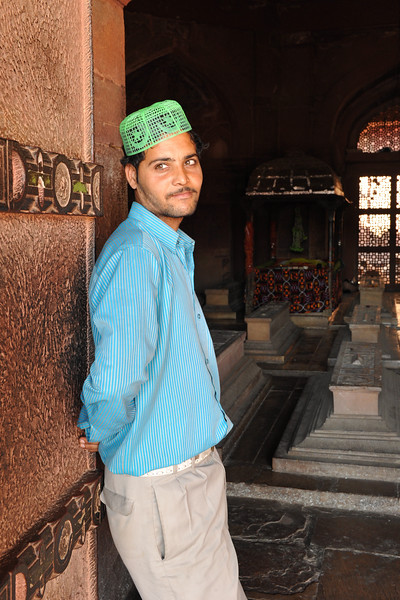 Person who helps those who come pray at the tombs at Fatehpur Sikri.<br /> Fatehpur Sikri (Hindi: फतेहपुर सीकरी, Urdu: فتحپور سیکری) is a city and a municipal board in Agra district in the state of Uttar Pradesh, in North India. The historical city was constructed by Mughal Emperor Akbar beginning in 1570 and served as the empire's capital from 1571 until 1585. Though it took 15 years to build, it was abandoned after only 14 years of use because of shortage of water supply which was unable to sustain the growing population. The palace and mosque in Fatehpur Sikri are a tourist attraction and it is an UNESCO World Heritage Site which is about 40 km from the Taj Mahal, Agra. Uttar Pradesh state (UP), North India.