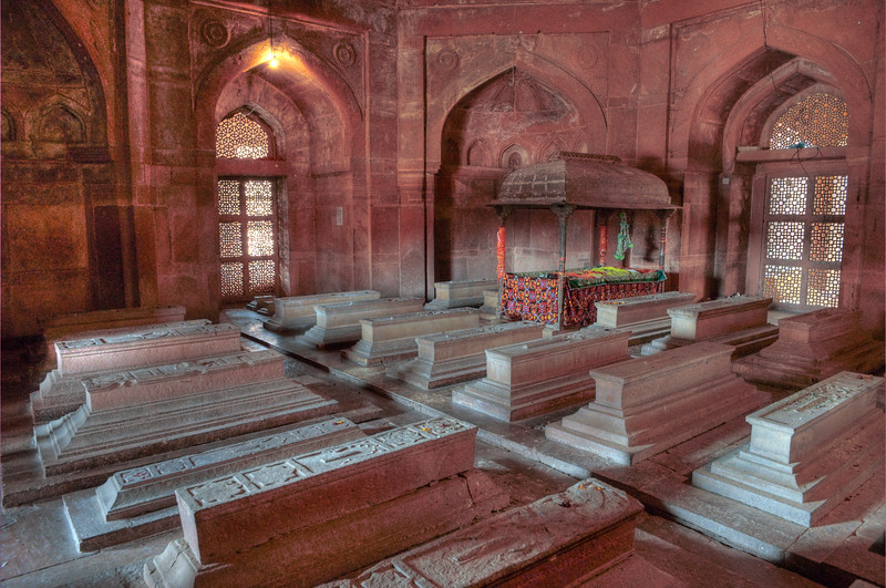 HDR image of Tombs at Fatehpur Sikri.<br /> Fatehpur Sikri (Hindi: फतेहपुर सीकरी, Urdu: فتحپور سیکری) is a city and a municipal board in Agra district in the state of Uttar Pradesh, in North India. The historical city was constructed by Mughal Emperor Akbar beginning in 1570 and served as the empire's capital from 1571 until 1585. Though it took 15 years to build, it was abandoned after only 14 years of use because of shortage of water supply which was unable to sustain the growing population. The palace and mosque in Fatehpur Sikri are a tourist attraction and it is an UNESCO World Heritage Site which is about 40 km from the Taj Mahal, Agra. Uttar Pradesh state (UP), North India.