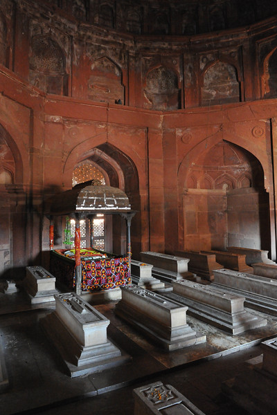 Tombs at Fatehpur Sikri.<br /> Fatehpur Sikri (Hindi: फतेहपुर सीकरी, Urdu: فتحپور سیکری) is a city and a municipal board in Agra district in the state of Uttar Pradesh, in North India. The historical city was constructed by Mughal Emperor Akbar beginning in 1570 and served as the empire's capital from 1571 until 1585. Though it took 15 years to build, it was abandoned after only 14 years of use because of shortage of water supply which was unable to sustain the growing population. The palace and mosque in Fatehpur Sikri are a tourist attraction and it is an UNESCO World Heritage Site which is about 40 km from the Taj Mahal, Agra. Uttar Pradesh state (UP), North India.