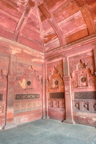 Decorated column at Agra Fort (Lal Qila).  It is about 2.5 km northwest of the Taj Mahal. The fort can be more accurately described as a walled palatial city.