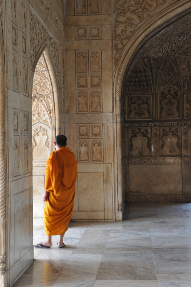 A buddhist monk inspects the Agra Fort.<br /> Agra Fort (Lal Qila) is a UNESCO World Heritage site. It is about 2.5 km northwest of the Taj Mahal. The fort can be more accurately described as a walled palatial city. Agra, Uttar Pradesh state (UP), North India.