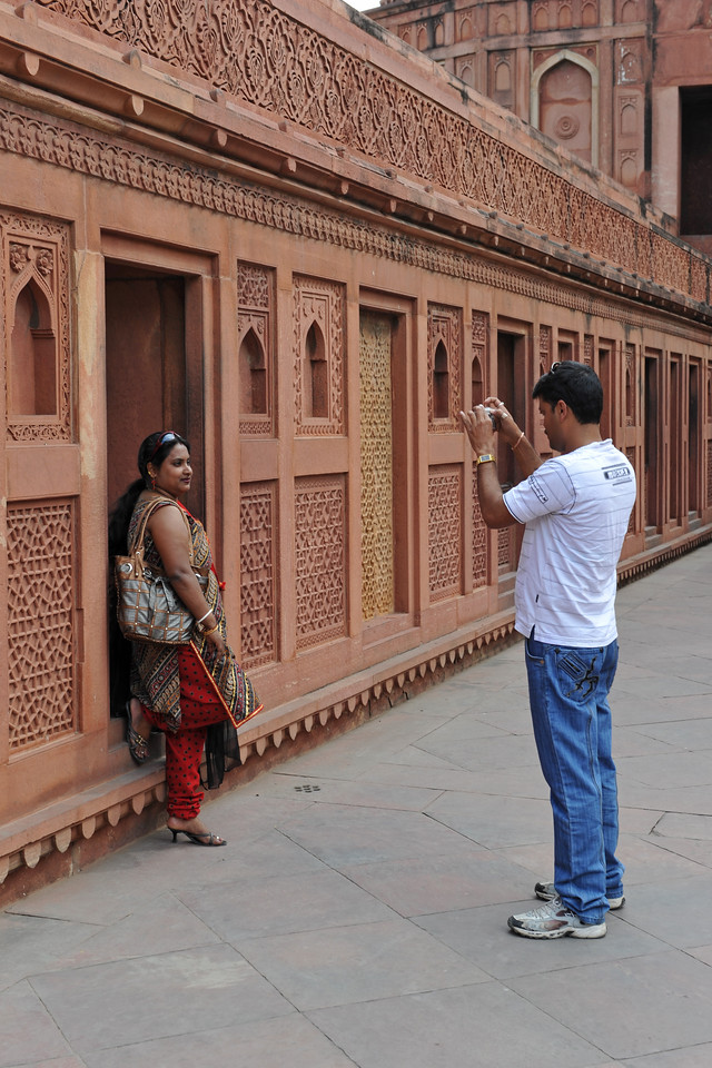 Visitors to the Agra Fort (Lal Qila) which is a UNESCO World Heritage site. It is about 2.5 km northwest of the Taj Mahal. The fort can be more accurately described as a walled palatial city.