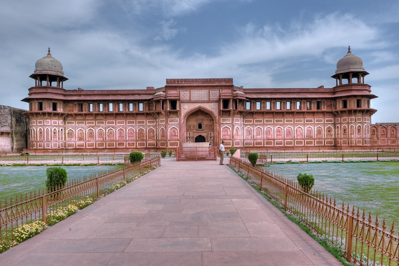 Jahangiri Mahal at Agra Fort, India.<br /> <br /> Jahangiri Mahal (Hindi: जहाँगीरी महल, Urdu: جہانگیری محل), is the most prominent building inside the Agra Fort of India. The Mahal was the principal zenana (palace for women belonging to the royal household), and was used mainly by the Rajput wives of Akbar. The building is made of red sandstone. A splendid gateway leads to an interior courtyard surrounded by grand halls covered with profuse carvings on stone, heavily fashioned brackets, piers, and crossbeams. One can still spot remnants of decoration in gold and blue done in the prevalent Indo-Persian style.
