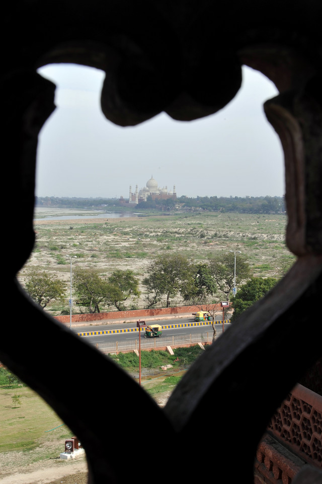Taj Mahal seen through the lattice works of Agra Fort.<br /> Agra Fort (Lal Qila) is a UNESCO World Heritage site. It is about 2.5 km northwest of the Taj Mahal. The fort can be more accurately described as a walled palatial city. Agra, Uttar Pradesh state (UP), North India.