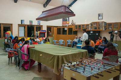 Guests playing games at the meeting room in Club Mahindra Binsar Valley Resort in the Kumaon Himalayan range. Binsar offers a breathtaking view of the snowy mountain ranges of Panchchuli, Shivling, Chaukhamba, Trishul and Nanda Devi.