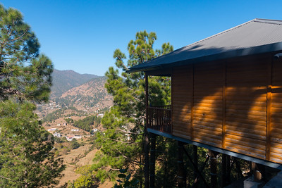 Cottage overhanging the valley at Club Mahindra Binsar Villa Uttarakhand Resort.  Perched high up in the Kumaon Himalayas, Binsar offers a breathtaking view of the snowy mountain ranges of Panchchuli, Shivling, Chaukhamba, Trishul and Nanda Devi. Nestled amid such beauty is Club Mahindra Binsar Valley.