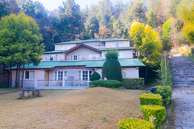 Club Mahindra Binsar Valley Resort cottages.  Perched high up in the Kumaon Himalayas, Binsar offers a breathtaking view of the snowy mountain ranges of Panchchuli, Shivling, Chaukhamba, Trishul and Nanda Devi. Nestled amid such beauty is Club Mahindra Binsar Valley.