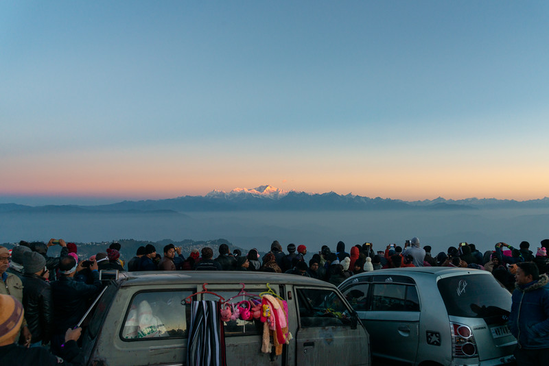 Sunrise draws crowds to Tiger Hill. Darjeeling, West Bengal, North East India.<br /> <br /> Awesome to see the sunrise at Kanchanzanga - 3rd highest peak of the world.<br /> <br /> Tiger Hill is located 11kms (6.8 miles) from Darjeeling town and above Ghum. It's the highest point in Darjeeling hills at an altitude of 8482 feet (or 2590 meters).