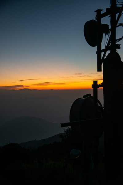 Communication antennas visible at sunrise on Tiger Hill. Darjeeling, West Bengal, North East India.<br /> <br /> Awesome to see the sunrise at Kanchanzanga - 3rd highest peak of the world.<br /> <br /> Tiger Hill is located 11kms (6.8 miles) from Darjeeling town and above Ghum. It's the highest point in Darjeeling hills at an altitude of 8482 feet (or 2590 meters).