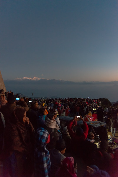 Large crowds gather to view the sunrise at Tiger Hill. Darjeeling, West Bengal, North East India.<br /> <br /> Awesome to see the sunrise at Kanchanzanga - 3rd highest peak of the world.<br /> <br /> Tiger Hill is located 11kms (6.8 miles) from Darjeeling town and above Ghum. It's the highest point in Darjeeling hills at an altitude of 8482 feet (or 2590 meters).
