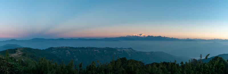 Panoramic view of sunrise at the Tiger Hill. Darjeeling, West Bengal, North East India.<br /> <br /> Awesome to see the sunrise at Kanchanzanga - 3rd highest peak of the world.<br /> <br /> Tiger Hill is located 11kms (6.8 miles) from Darjeeling town and above Ghum. It's the highest point in Darjeeling hills at an altitude of 8482 feet (or 2590 meters).