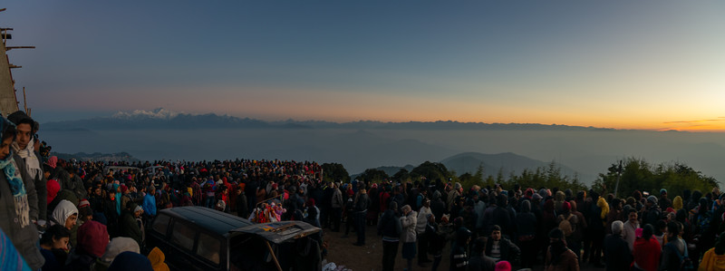 Panoramic view of sunrise at the Tiger Hill. Darjeeling, West Bengal, North East India attracts a very large crowd.<br /> <br /> Awesome to see the sunrise at Kanchanzanga - 3rd highest peak of the world.<br /> <br /> Tiger Hill is located 11kms (6.8 miles) from Darjeeling town and above Ghum. It's the highest point in Darjeeling hills at an altitude of 8482 feet (or 2590 meters).