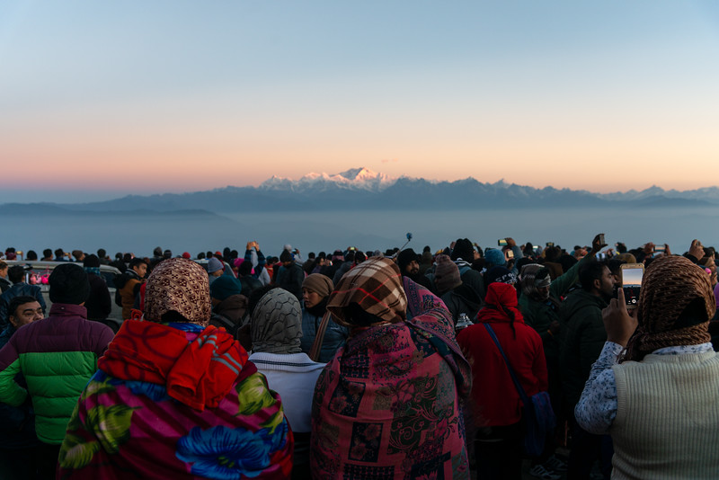 Crowds gathered at sunrise on Tiger Hill. Darjeeling, West Bengal, North East India.<br /> <br /> Awesome to see the sunrise at Kanchanzanga - 3rd highest peak of the world.<br /> <br /> Tiger Hill is located 11kms (6.8 miles) from Darjeeling town and above Ghum. It's the highest point in Darjeeling hills at an altitude of 8482 feet (or 2590 meters).