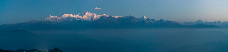 Panoramic view of the mountains at sunrise on Tiger Hill. Darjeeling, West Bengal, North East India.<br /> <br /> Awesome to see the sunrise at Kanchanzanga - 3rd highest peak of the world.<br /> <br /> Tiger Hill is located 11kms (6.8 miles) from Darjeeling town and above Ghum. It's the highest point in Darjeeling hills at an altitude of 8482 feet (or 2590 meters).
