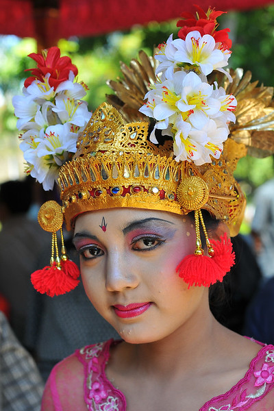 "Portrait shots of Ms. Putu (Ms. Riskiana Dewi), the  Balinese dancer who performed at the Bali Art Festival (Pesta Kesenian Bali) at Denpasar, Bali. June, 2009<br /> <br /> Bali Art Center is located on Nusa Indah Street, about 2 Kms distance from the City Centre or Puputan Badung Park. The Art Centre was officially opened in February 14th, 1973. The Art Centre is a building - complex with Balinese traditional architecture with an extent of about 5 hectares consisted of: Exhibition Hall called Mahudara Mandhara Giri Bhuana where paintings and other traditional Balinese objects are exhibited. The Hall is located on the north side of the Art Centre Complex. The Ksirarnawa Hall, a two-storey hall in which various kinds of performing arts are on stage on the upper floor white exhibitions of handicrafts, gold and silverworks are held on the first floor. The Ardha Candra open stage is located on the Eastern side, on which traditional performing-arts, music-concerts and fashion-shows are often held, The Wantilan Hall is also used for similar purpose. The Art Centre had the Arts festival going on when we visited. <br /> See more details at:  <a href=""http://www.baliartsfestival.com/"">http://www.baliartsfestival.com/</a>"