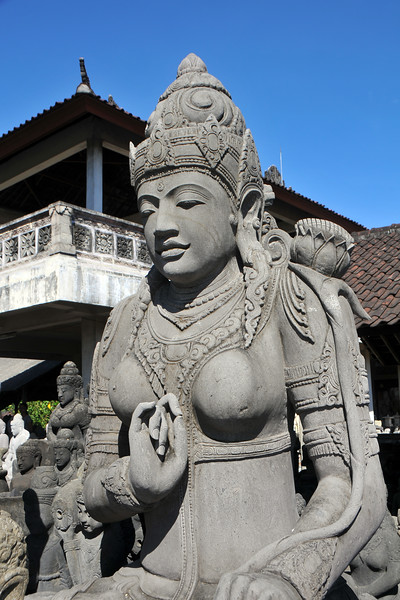 Between Ubud and Denpasar near one Celuk as one drives on the main road one comes across kilometers and kilometers of shops on either side selling stone carvings. Literally hundreds of carved works are available here. Bali, Indonesia.