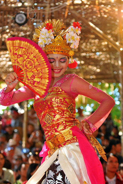 "Social Dance Joged Bumbung presented by Winagun Semara Mendoyo Dangin Tukad Vilalge Jembrana Regency at 11.00 am on 25th June 2009 at the Ayodya Stage.<br /> Ms. Putu (Ms. Riskiana Dewi), was the  Balinese dancer who performed at the Bali Art Festival (Pesta Kesenian Bali) at Denpasar, Bali. June, 2009<br /> <br /> Bali Art Center is located on Nusa Indah Street, about 2 Kms distance from the City Centre or Puputan Badung Park. The Art Centre was officially opened in February 14th, 1973. The Art Centre is a building - complex with Balinese traditional architecture with an extent of about 5 hectares consisted of: Exhibition Hall called Mahudara Mandhara Giri Bhuana where paintings and other traditional Balinese objects are exhibited. The Hall is located on the north side of the Art Centre Complex. The Ksirarnawa Hall, a two-storey hall in which various kinds of performing arts are on stage on the upper floor white exhibitions of handicrafts, gold and silverworks are held on the first floor. The Ardha Candra open stage is located on the Eastern side, on which traditional performing-arts, music-concerts and fashion-shows are often held, The Wantilan Hall is also used for similar purpose. The Art Centre had the Arts festival going on when we visited. <br /> See more details at:  <a href=""http://www.baliartsfestival.com/"">http://www.baliartsfestival.com/</a>"