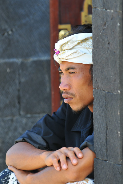 "Security person at The Mother Temple of Besakih<br /> The Mother Temple of Besakih - Pura Besakih in the village of Besakih on the slopes of Mount Agung in eastern Bali, is the most important temple of Agama Hindu Dharma in Bali, Indonesia and is one of a series of Balinese temples. It has been nominated as an UNESCO World Heritage Site.<br /> <br /> A series of eruptions of Mount Agung in 1963, which killed approximately 1,700 people also threatened Puru Besakih but fortunately, the lava flows missed the temple complex by mere yards. The saving of the temple is regarded by the Balinese people as miraculous, and a signal from the Gods.<br /> <br /> This temple was built in a holy village named Hulundang Basukih, which is known today as Besakih village. The name of Besakih was derived from the word ""Basuki"" or in some old manuscripts written as Basukir or Basukih. The word Basuki itself was taken from the word ""Wasuki"" on the Sunskrit, which means ""salvation"".<br /> <br /> The mythology of Samudramanthana mentioned that Basuki was the name of a dragon that coiled around the Mandara Mountain.<br /> <br /> The old remains say that the Besakih Temple was built by Rsi Markandya and his followers in the 11th century. At that time, Rsi Markandya intended to go to Mount Agung to build a residence. The construction was troubled by a disease which caused the death of his followers. For the safety of them, he constructed a veneration to worship God for a salvation. The veneration was called ""Sanggar Basuki""."
