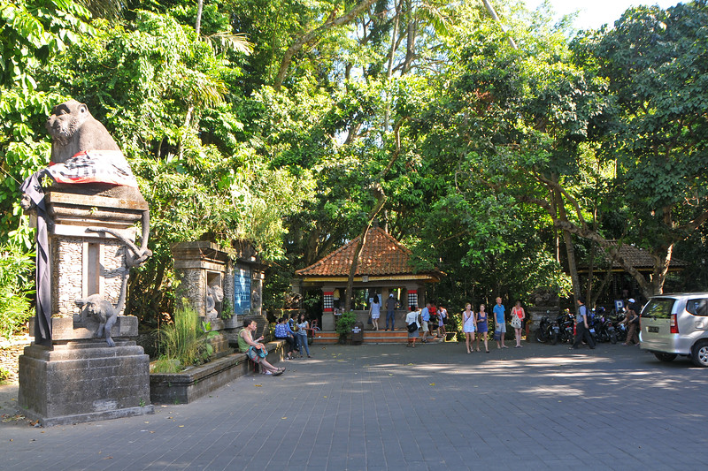 Entrance to Entrance to The Padangtegal Mandala Wisata Wanara Wana Sacred Monkey Forest Sanctuary. Dalem Agung Padantegal Temple, Sacred Monkey Forest, Ubud.<br /> The Ubud Monkey Forest is a nature reserve and temple complex in Ubud, Bali. It houses over 200 Crab-eating Macaque (Macaca fascicularis) monkeys. There are four groups of monkeys each occupying different territories in the park. The Sacred Monkey Forest is a popular tourist attraction in Ubud.<br /> <br /> Bali is an Indonesian island with the provincial capital at Denpasar. Lying between Java to the west and Lombok to the east, the island is home to the largest tourist destination in the country and is renowned for its highly developed arts, including dance, sculpture, painting, leather, metalworking and music. What's interesting is that while Indonesia has the world's largest Muslim population, on the island of Bali, 93% of the population is Balinese Hindu and one can find Hinduism in each and every aspect of the life and living.