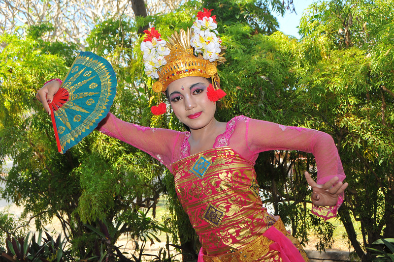"Portrait of Ms. Putu (Ms. Riskiana Dewi), showing the various dance forms. She was the  Balinese dancer who performed at the Bali Art Festival (Pesta Kesenian Bali) at Denpasar, Bali. June, 2009<br /> <br /> Bali Art Center is located on Nusa Indah Street, about 2 Kms distance from the City Centre or Puputan Badung Park. The Art Centre was officially opened in February 14th, 1973. The Art Centre is a building - complex with Balinese traditional architecture with an extent of about 5 hectares consisted of: Exhibition Hall called Mahudara Mandhara Giri Bhuana where paintings and other traditional Balinese objects are exhibited. The Hall is located on the north side of the Art Centre Complex. The Ksirarnawa Hall, a two-storey hall in which various kinds of performing arts are on stage on the upper floor white exhibitions of handicrafts, gold and silverworks are held on the first floor. The Ardha Candra open stage is located on the Eastern side, on which traditional performing-arts, music-concerts and fashion-shows are often held, The Wantilan Hall is also used for similar purpose. The Art Centre had the Arts festival going on when we visited. <br /> See more details at:  <a href=""http://www.baliartsfestival.com/"">http://www.baliartsfestival.com/</a>"