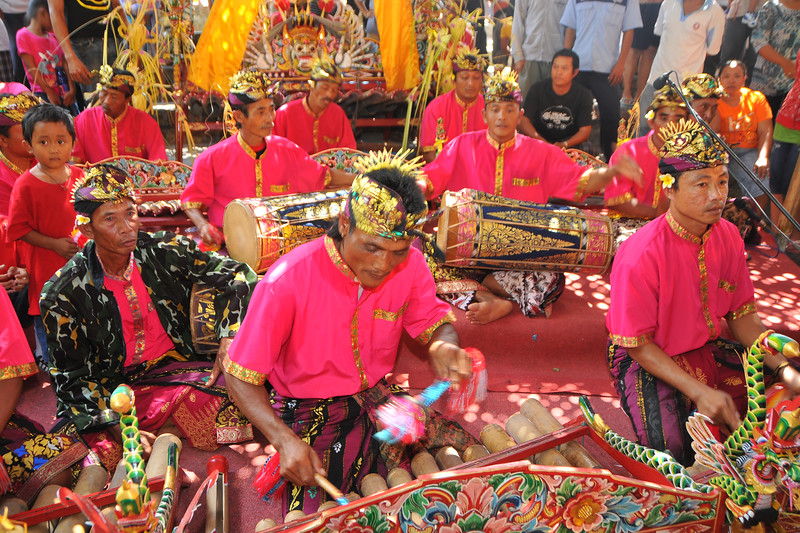 "Musicians at the Bali Art Center. The Center is located on Nusa Indah Street, about 2 Kms distance from the City Centre or Puputan Badung Park. The Art Centre was officially opened in February 14th, 1973. The Art Centre is a building - complex with Balinese traditional architecture with an extent of about 5 hectares consisted of: Exhibition Hall called Mahudara Mandhara Giri Bhuana where paintings and other traditional Balinese objects are exhibited. The Hall is located on the north side of the Art Centre Complex. The Ksirarnawa Hall, a two-storey hall in which various kinds of performing arts are on stage on the upper floor white exhibitions of handicrafts, gold and silverworks are held on the first floor. The Ardha Candra open stage is located on the Eastern side, on which traditional performing-arts, music-concerts and fashion-shows are often held, The Wantilan Hall is also used for similar purpose. The Art Centre had the Arts festival going on when we visited. <br /> See more details at:  <a href=""http://www.baliartsfestival.com/"">http://www.baliartsfestival.com/</a>"