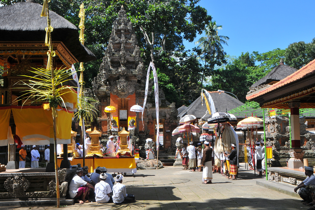 Ceremony taking place in Dalem Agung Padantegal Temple, Sacred Monkey Forest, Ubud.<br /> The vast majority of the Balinese follow one religion - A Shivaite sect of Hinduism that is mixed with pre-Hindu mythologies. The Balinese from before the third wave of immigration, known as the Bali Aga, are mostly not followers of the Balinese Shivaite Hinduism, but their own animist traditions.<br /> <br /> Bali is an Indonesian island with the provincial capital at Denpasar. Lying between Java to the west and Lombok to the east, the island is home to the largest tourist destination in the country and is renowned for its highly developed arts, including dance, sculpture, painting, leather, metalworking and music. What's interesting is that while Indonesia has the world's largest Muslim population, on the island of Bali, 93% of the population is Balinese Hindu and one can find Hinduism in each and every aspect of the life and living.
