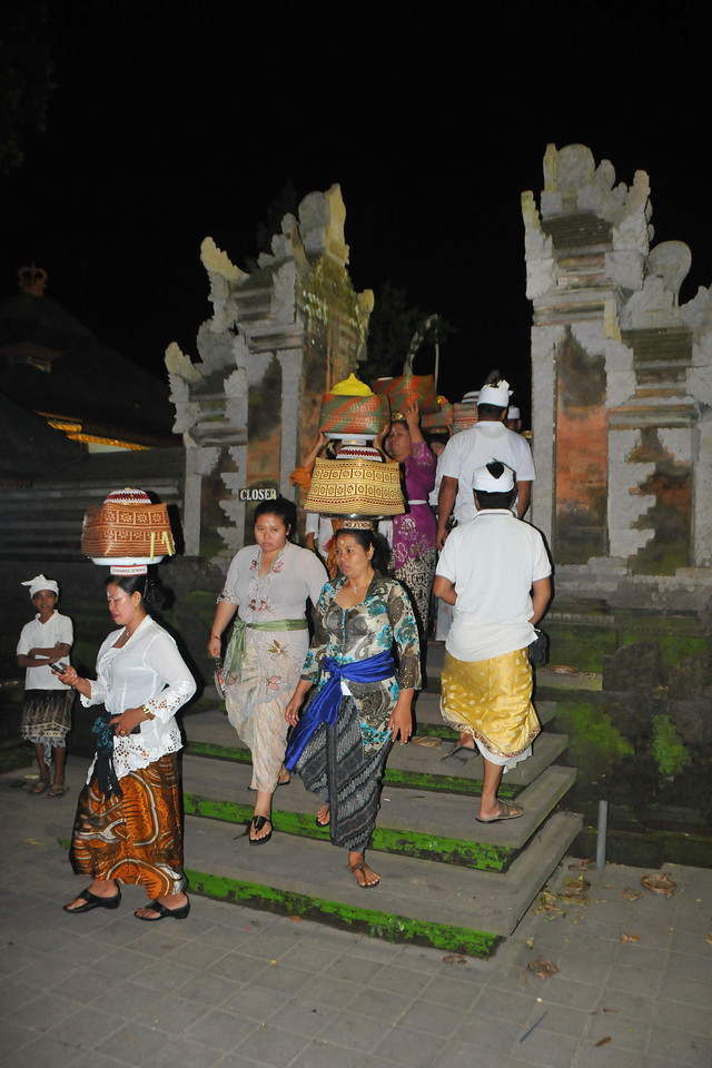 Men and particularly women carrying offerings on their head at the ceremony taking place in Dalem Agung Padantegal Temple, Sacred Monkey Forest, Ubud.<br /> Bali is an Indonesian island with the provincial capital at Denpasar. Lying between Java to the west and Lombok to the east, the island is home to the largest tourist destination in the country and is renowned for its highly developed arts, including dance, sculpture, painting, leather, metalworking and music. What's interesting is that while Indonesia has the world's largest Muslim population, on the island of Bali, 93% of the population is Balinese Hindu and one can find Hinduism in each and every aspect of the life and living.