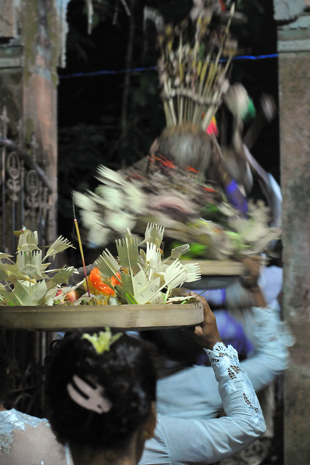 Group of women going around the inner sactorium of the temple. Offerings being made as part of a ceremony taking place in Dalem Agung Padantegal Temple, Sacred Monkey Forest, Ubud.<br /> <br /> Balinese performing arts often portray stories from Hindu epics such as the Ramayana but with heavy Balinese influence. Famous Balinese dances include pendet, legong, baris, topeng, barong, gong keybar, and kecak (the monkey dance). Bali boasts one of the most diverse and innovative performing arts cultures in the world, with paid performances at thousands of temple festivals, private ceremonies, or public shows.